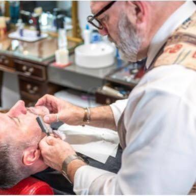 Ross doing a hot towel shave with an open razor
