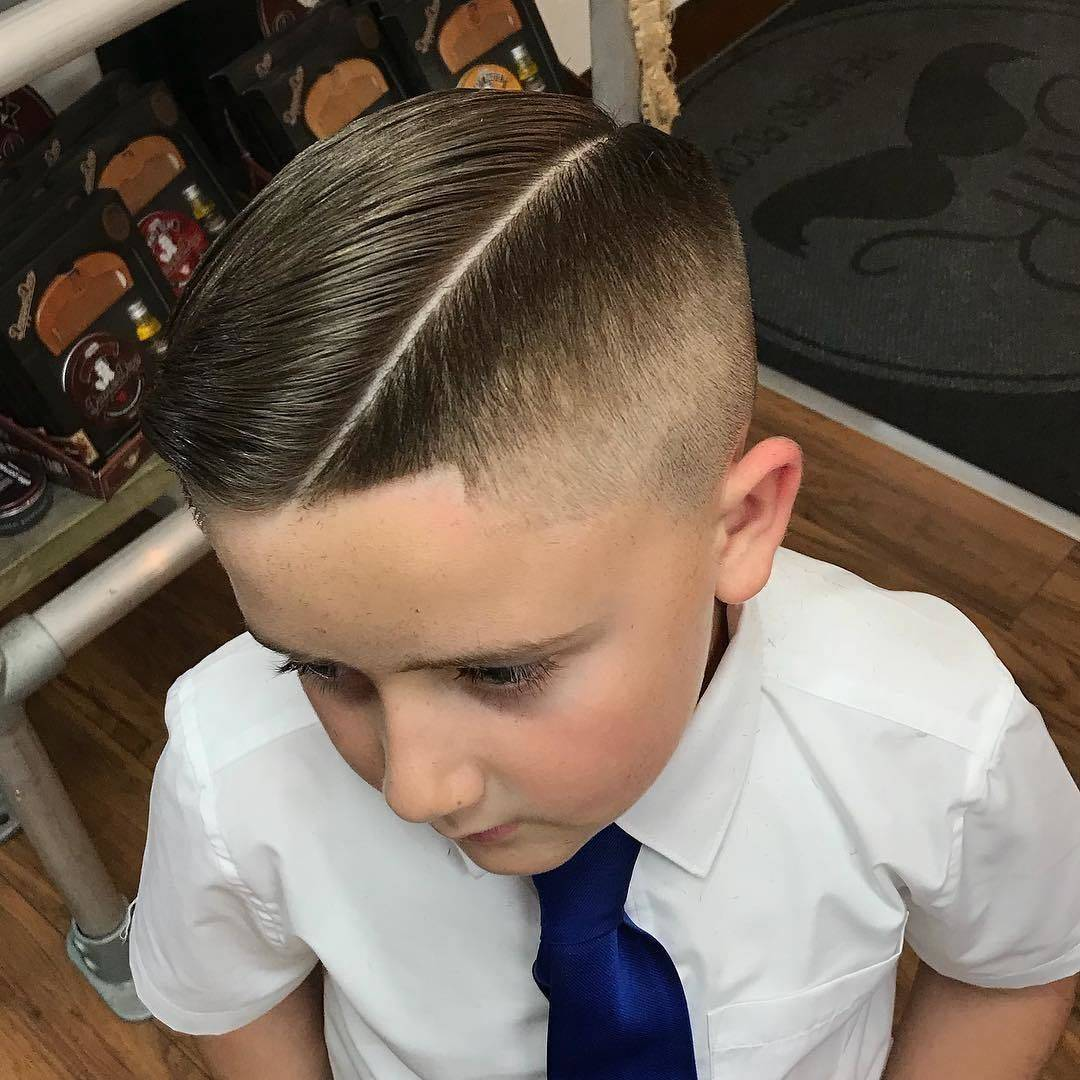 Another cool kid  0.5 fade @hairbyhatto 🦅🦅  •  • • #coolkids #boyshaircut #barbershop #barber #barbershopconnect #hairstyle #health #fitness #hardpart #fade #andis #wahl