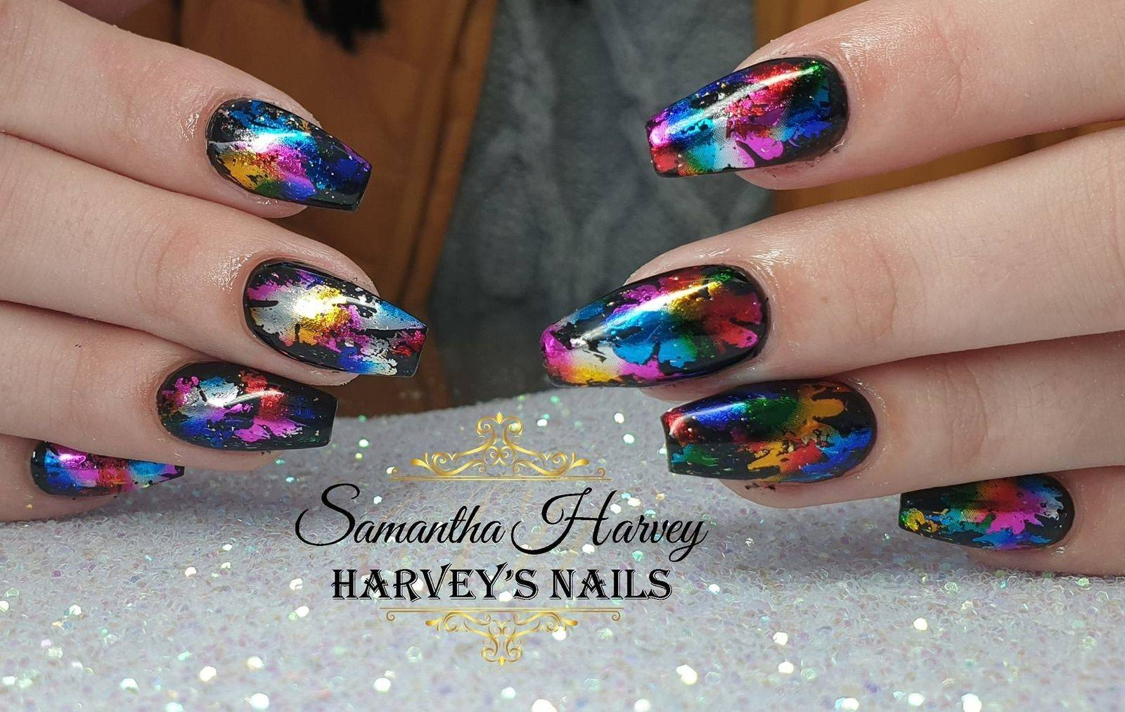 Acrylic extensions, finished with Gel polish and foil design