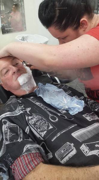 Our apprentice  mollie attempting her first hot towel/steam shave. . Shes smashing it!