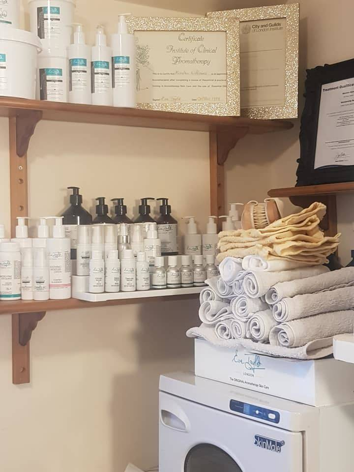 Overspill from facial trolly, spa body products and Eve Taylor hydrolats. Facial towels ready and waiting for the hot towel cabinet below.