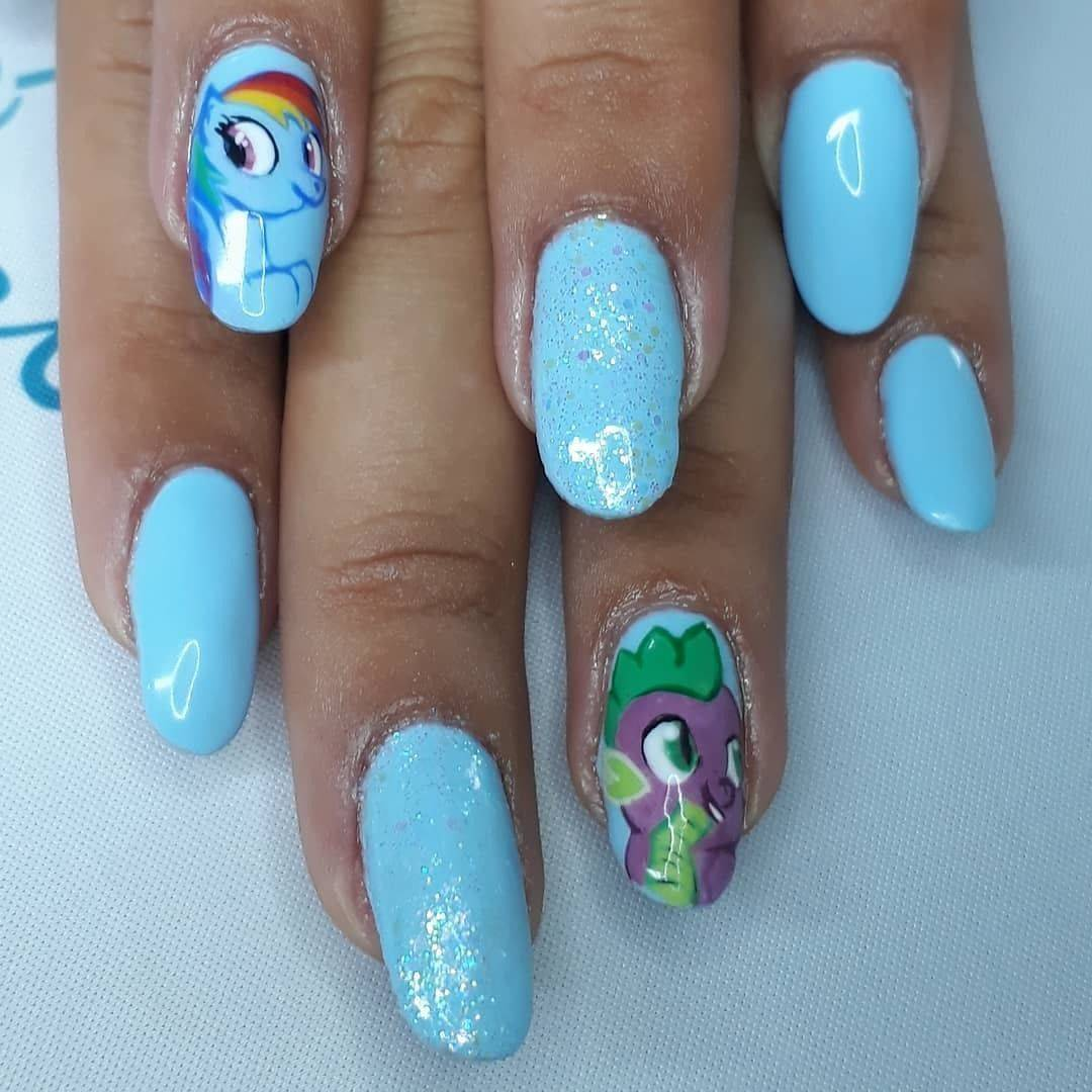 Rainbow dash & Spike. Really enjoyed doing these today for the gorgeous Charis #missioncontrolgelpaint #youngnails  #ManiQ #mlpnails #rainbowdash #gelpolish