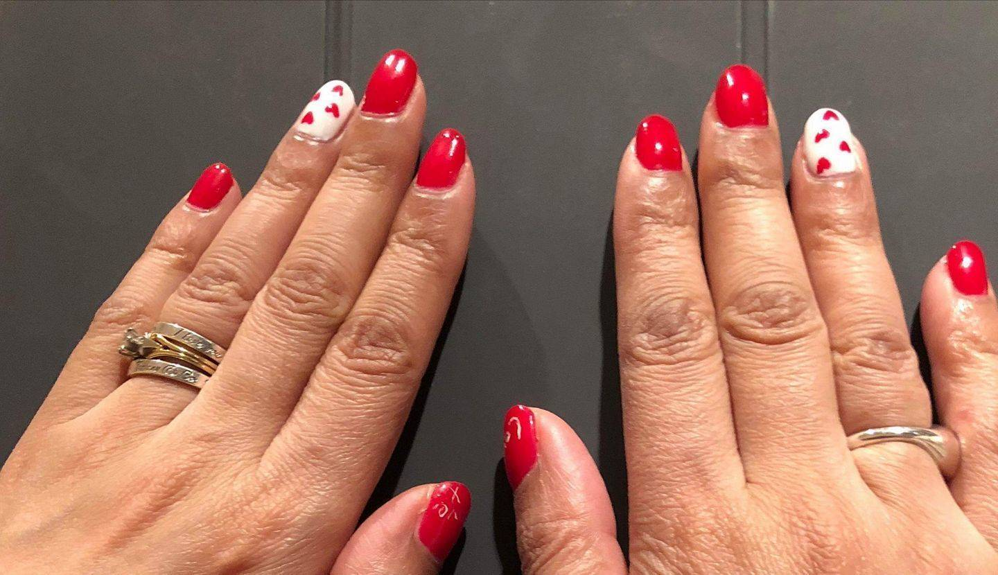 Gel polish valentine's nails with cute little hearts