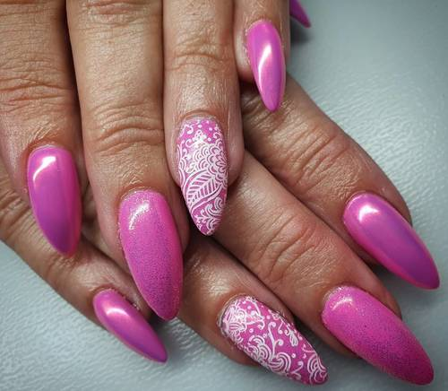 Pretty in pink. Pixie chrome gives a metallic finish that shines orangey-pink. Lovely over warm shades. #chromenails #nailsoftheday #nailextensions #gelnails #pinknails #nailsalon