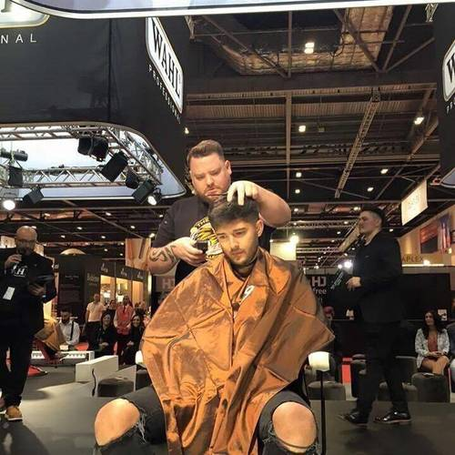 Davie on stage at London British Barber Of The Year runner up